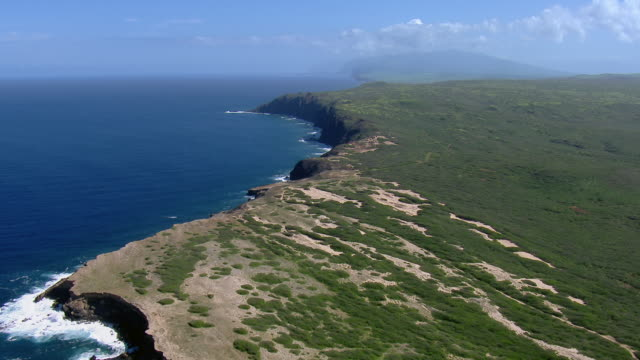 Stunning aerial shot, approaching the northwest tip of Molokai and flying along the cliffs of its north coast.