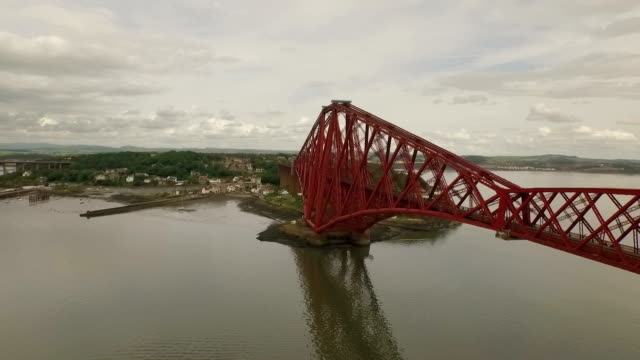 Stunning aerial shot of the Forth Rail Bridge during the day in South Queensferry