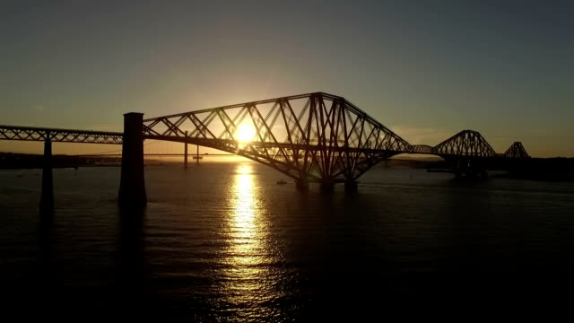 stunning aerial shot of the forth rail bridge from in south queenferry during a sunset - twilight stock videos & royalty-free footage