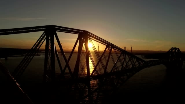 Stunning aerial shot of the Forth Rail Bridge from in South Queenferry during a sunset