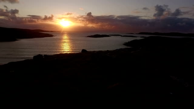 stunning aerial shot on the isle of harris, scotland, flying along the coastline at uig - hebrides stock videos & royalty-free footage