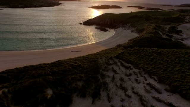 Stunning aerial shot on the Isle of Harris, Scotland, flying along the coastline at Uig