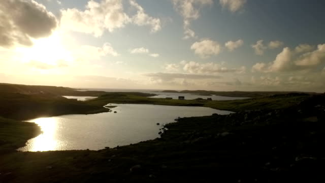 stunning aerial shot on the isle of harris, scotland, flying along the coastline at uig - twilight stock videos & royalty-free footage