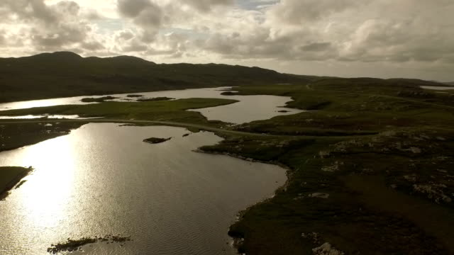 stunning aerial shot on the isle of harris, scotland, flying along the coastline at uig during sunset - hebrides stock videos & royalty-free footage