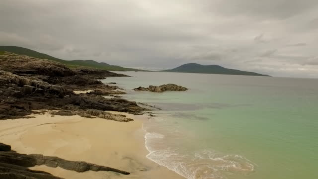 Stunning aerial shot on the Isle of Harris, Scotland near the coast showing water and beaches