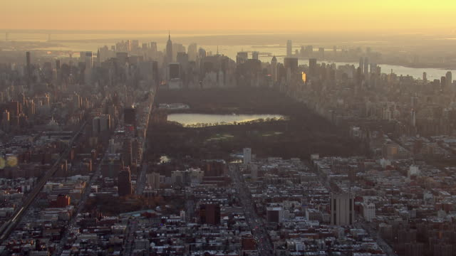 Stunning aerial view looking south over the island of Manhattan at sunset.