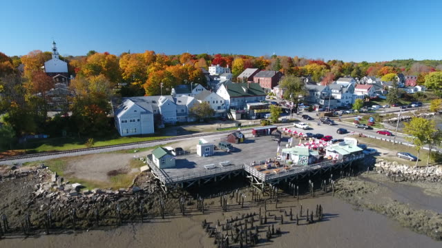 a stunning aerial view of a classic small town in maine at the peak of fall. wicasset. maine usa - town stock videos & royalty-free footage