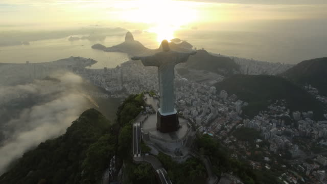 stunning aerial view of christ the redeemer at sunrise in rio de janeiro brazil - rio de janeiro stock videos & royalty-free footage