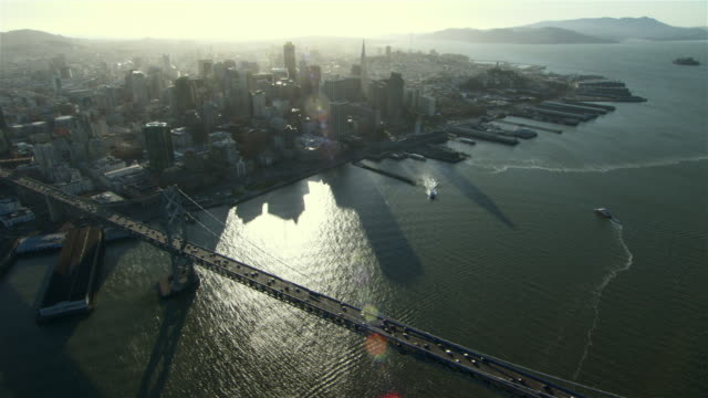 stunning aerial view of downtown san francisco from over the oakland bay bridge. - san francisco bay stock videos and b-roll footage