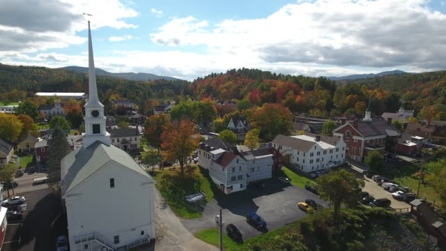stunning aerial view of stowe, vermont. usa - vermont stock-videos und b-roll-filmmaterial