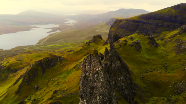 stunning aerial view of the old man of storr in the mountains of the skye island. - スコットランド点の映像素材/bロール