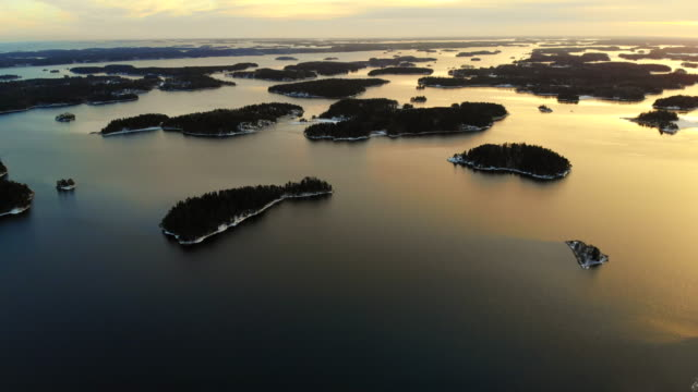 stunning aerial view of the stockholm archipelago islands with sunset light. - stockholm stock-videos und b-roll-filmmaterial