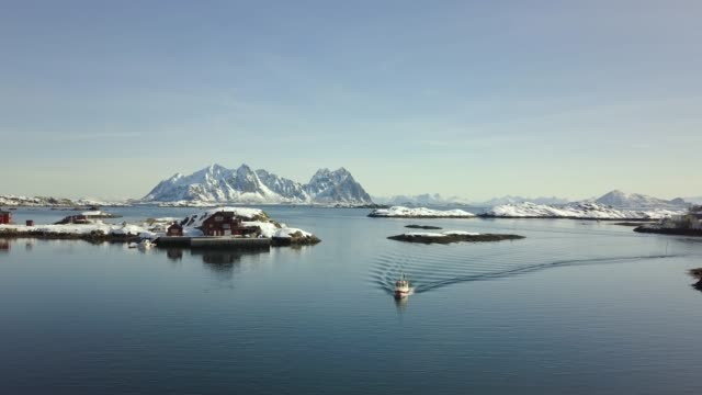 stockvideo's en b-roll-footage met stunning luchtfoto over lofoten, noorwegen op een mooie winterdag. - nautical vessel