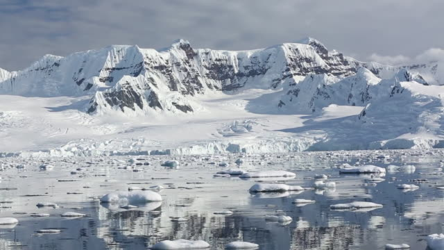 Stunning and pristine glacial and mountain scenery in the Gerlache Strait separating the Palmer Archipelago from the Antarctic Peninsular off Anvers Island. The Antartic Peninsular is one of the fastest warming areas of the planet.