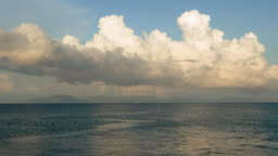 Stunning clouds over the smooth surface of the Mediterranean sea. 4K