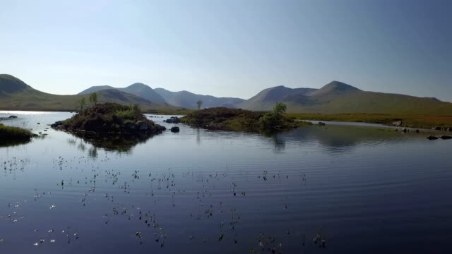 Stunning drone shot in Scotland of Lochan na h-Achlaise by Rannoch Moor on the A83 towards Glen Coe