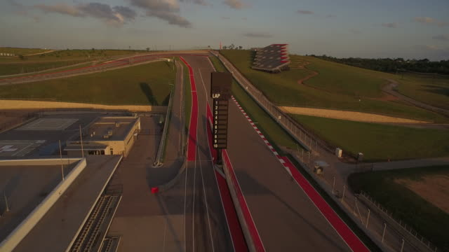 stunning fly over of turn 1 at the circuit of the americas austin formula 1 track - sports track stock videos and b-roll footage