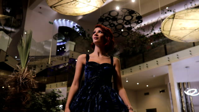 stunning redhead woman in blue dress - luxury hotel stock videos & royalty-free footage