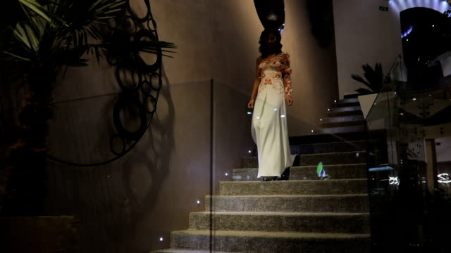 stunning woman in white dress walking down the steps - stereotypically upper class stock videos & royalty-free footage