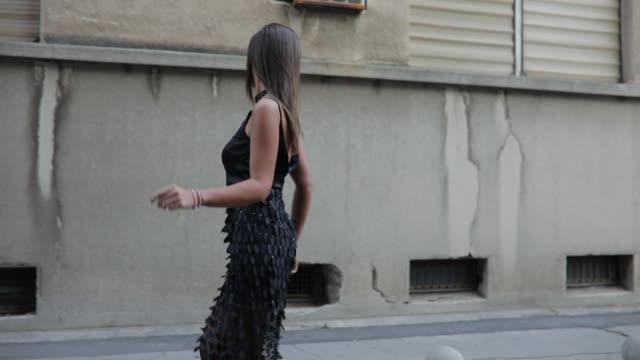 stunning young lady - vestito nero video stock e b–roll