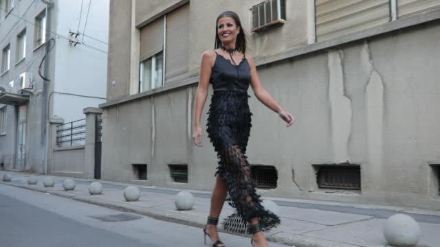 stunning young woman - vestito nero video stock e b–roll
