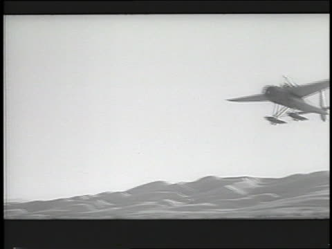 PAN stunt airplane descending over desert during filming