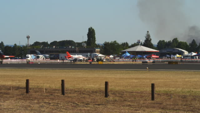 stunt jet taxiing through frame at an air show - taxiway stock videos & royalty-free footage