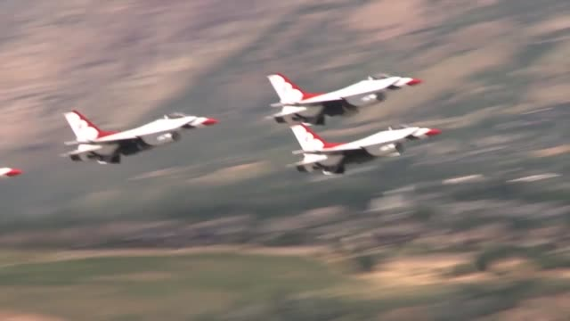 Stunt planes the Army Golden warriors and the US Air Force Thunderbirds perform for a civilian and military audience at the Warriors over the Wasatch...