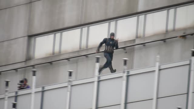 A stuntman dressed as Captain America sighted filming on the set of Captain America Civil War on August 12 2015 in Berlin Germany