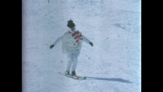 stuntman in skis dressed as a snowman coming over a small skijump and this is repeated in slow motion / 8mm amateur home movie footage filmed by the... - leo mckern stock videos and b-roll footage