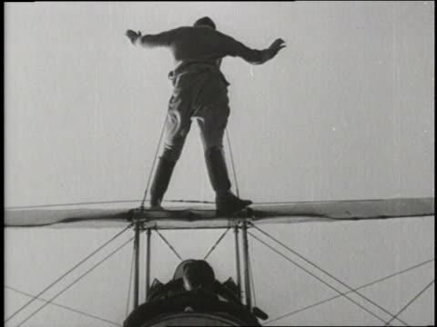 stuntmen do dangerous stunts on airplanes. - stunt person stock videos & royalty-free footage