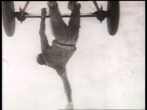 stuntmen perform tricks on aircraft in flight. - 複葉機点の映像素材/bロール