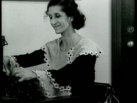stunts and nuts newsreel / a woman sitting at a remington typewriter sings and types to match her rhythm / she addresses the audience now girls / - rhythm stock videos and b-roll footage