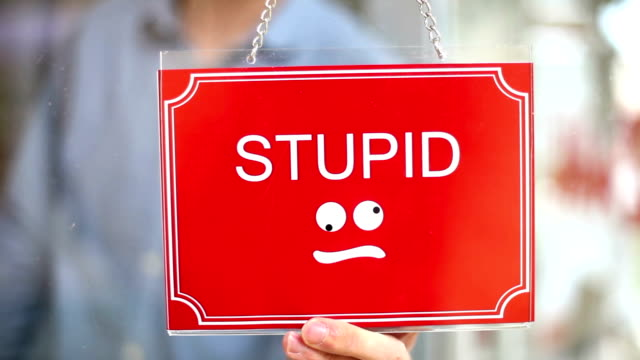 stupid - clever sign - oblivious stock videos & royalty-free footage
