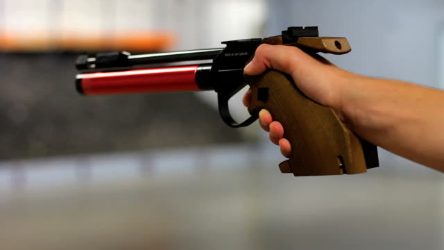 . style gun shooting - pistol stock videos and b-roll footage