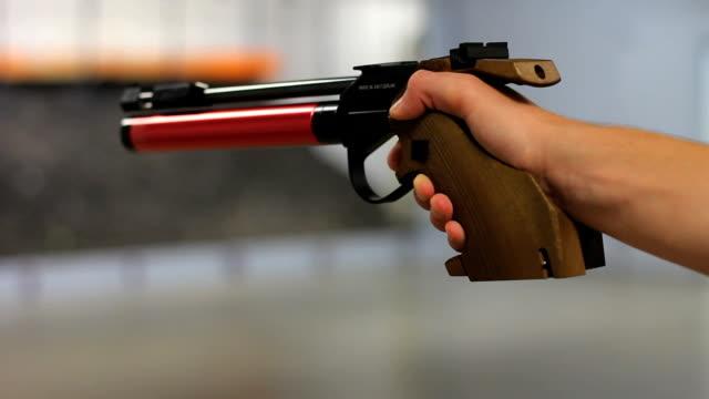 . style gun shooting - handgun stock videos and b-roll footage