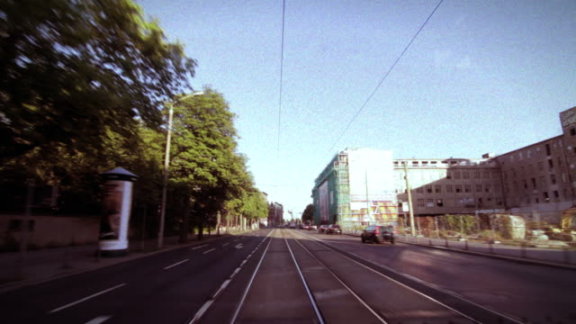 vidéos et rushes de a stylised hyperlapse view of leipzig city from the rear of the tram - ligne de tramway