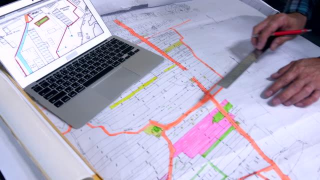 stylish architect working on blueprint