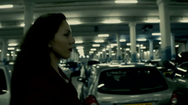 stylish businesswoman walking hastily along the underground parking lot - parking stock videos and b-roll footage