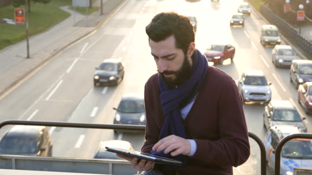 Stylish male with tablet