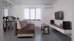 Stylish modern living room. Apartments for rent. TV and sofa with a coffee table