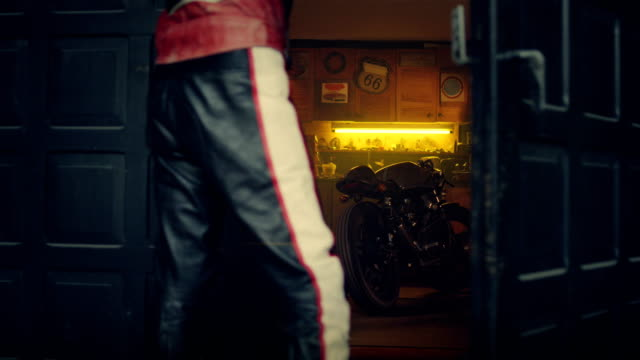 stylish vintage hobby motorcycle garage. man entering workshop - repair garage stock videos & royalty-free footage