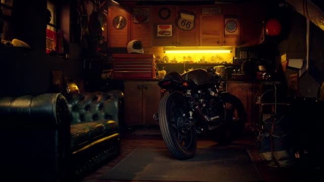 stylish vintage hobby motorcycle garage workshop - repair garage stock videos & royalty-free footage