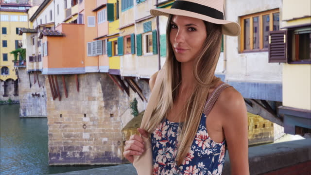 stylish woman in her 20s wearing fedora and romper traveling in florence, italy - ponte stock videos & royalty-free footage