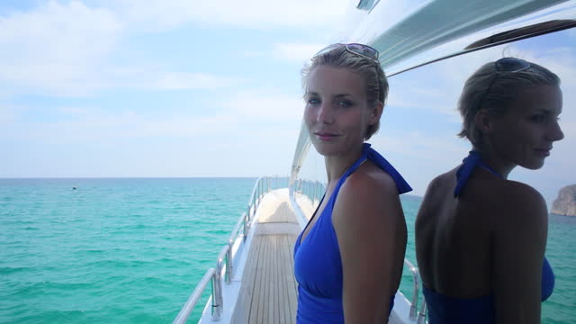 stylish woman on standing at the side of a luxury yacht. - majorca stock videos & royalty-free footage