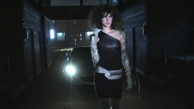 ms, td, tu, stylish young woman walking in front of sport car in garage, kingston, new york, usa - dominatrix stock videos and b-roll footage