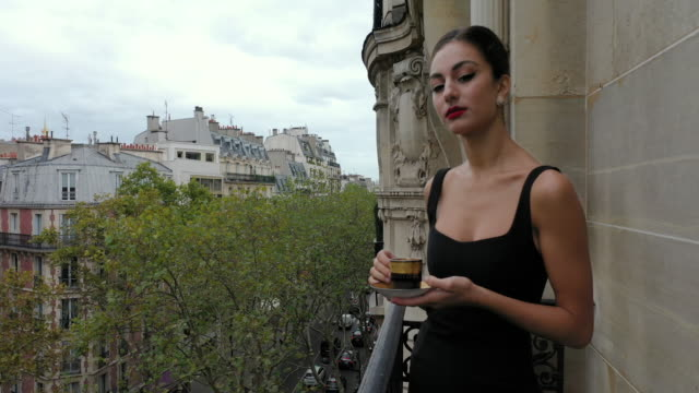stylish young women drinking coffee on her balcony in paris france, daytime - mug stock videos & royalty-free footage
