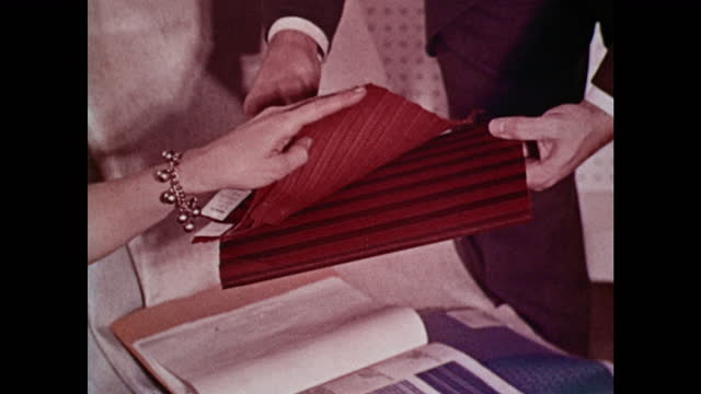 1963 amc stylists compare fabric and metal trim samples for rambler - 1963 stock videos & royalty-free footage