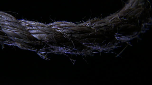 stylized *section of natural fiber rope hanging in air w/ slight movement. symbol, capital punishment, knot, execution, hanging, lynching. - hanging execution stock-videos und b-roll-filmmaterial