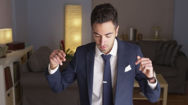 suave businessman dancing - festlich gekleidet stock-videos und b-roll-filmmaterial
